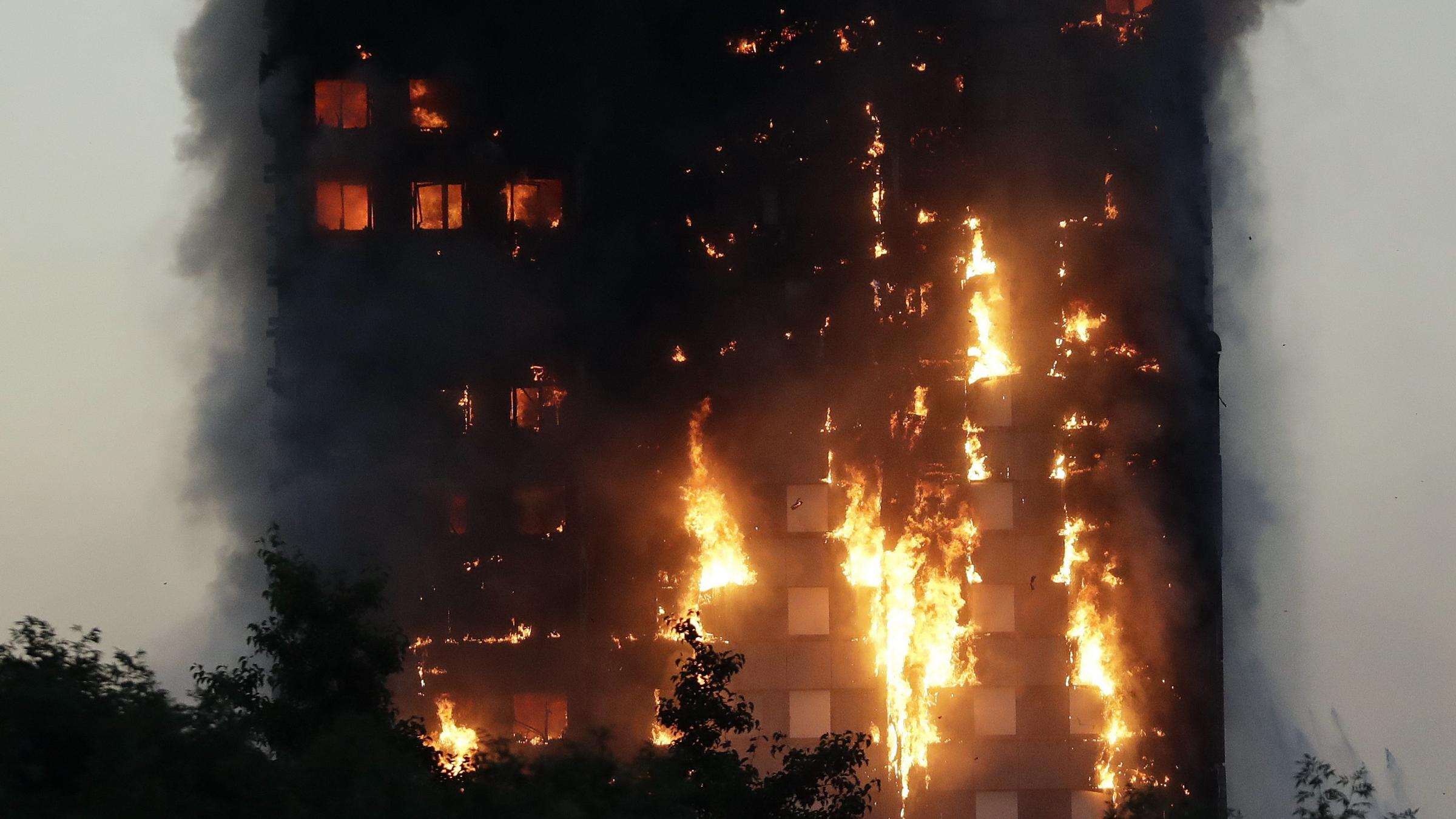12 dead as fire engulfs London tower block